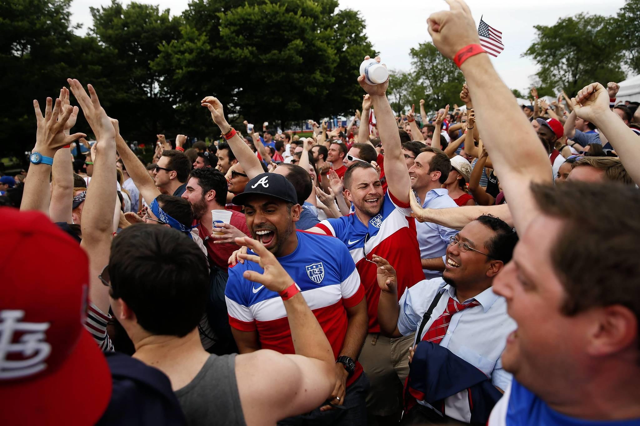 U.S. fans in Grant Park celebrate the team's game-winning goal against Ghana.