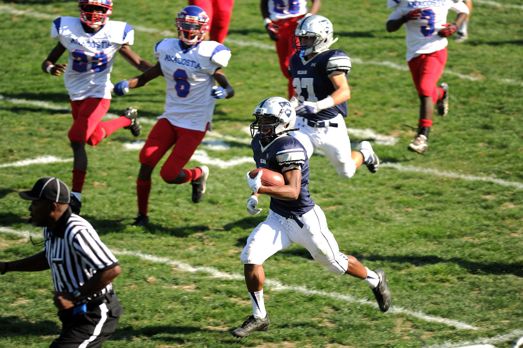 GIlman's Jelani Roberts returns a punt for a touchdown against Anacostia last season.