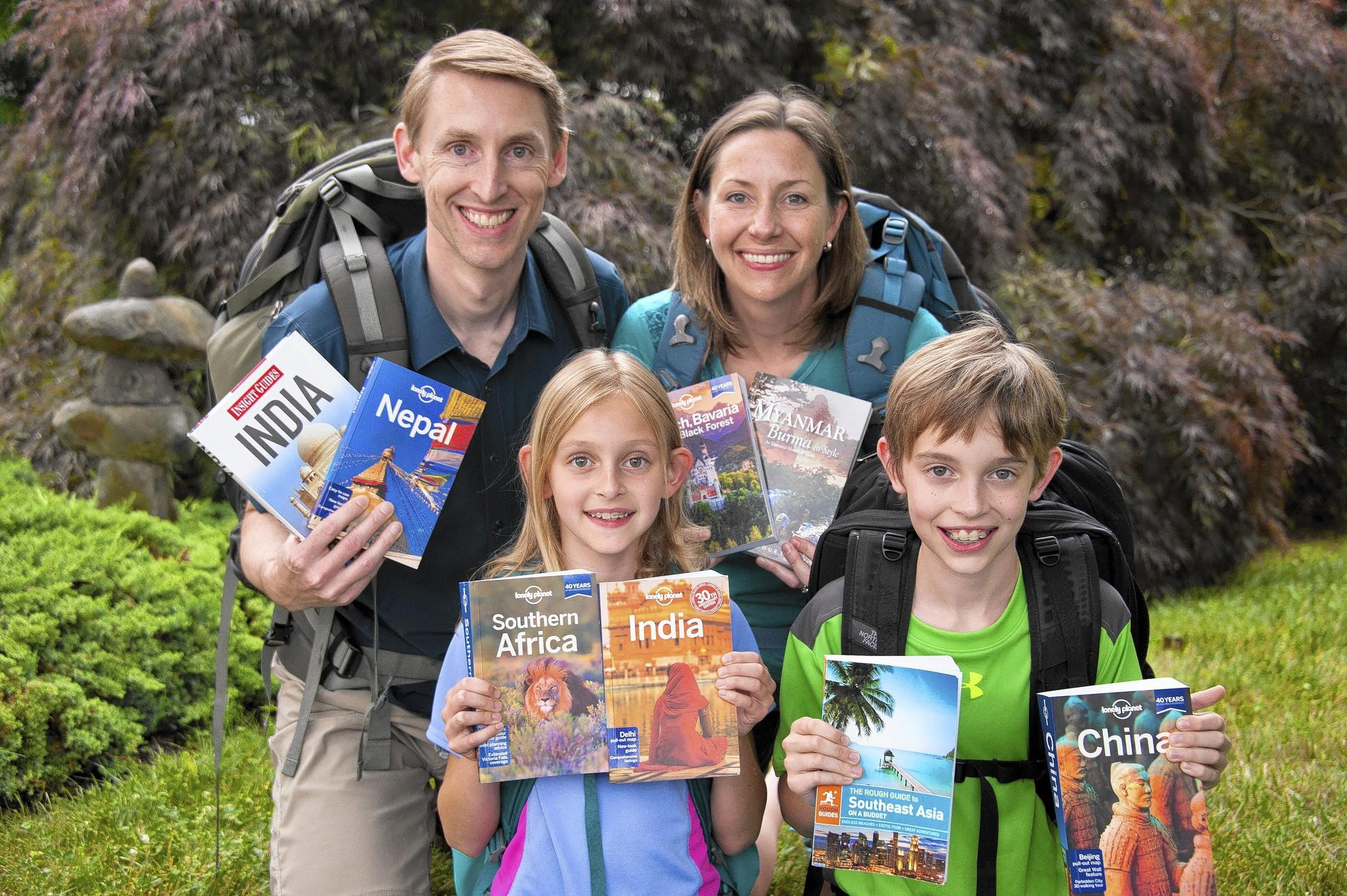 Julie and Tim Rivenbark with their children, Kara Rivenbark, 9 and Tyler Rivenbark, 11, talk about their upcoming world trip. The family plan to explore the world and blog about their experiences.
