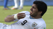 Luis Suarez suspended for nine matches by FIFA for biting incident