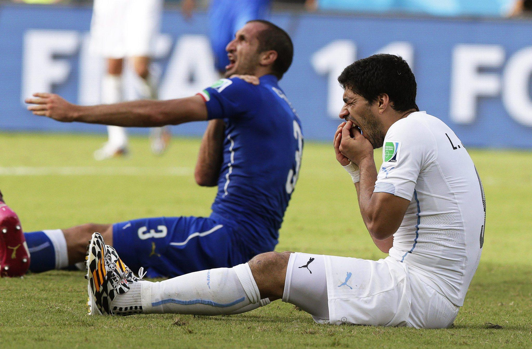 Italy's Giorgio Chiellini (left) claims he was bitten by Uruguay's Luis Suarez during the FIFA World Cup 2014 Group D preliminary round match between Italy and Uruguay at the Estadio Arena das Dunas in Natal, Brazil.