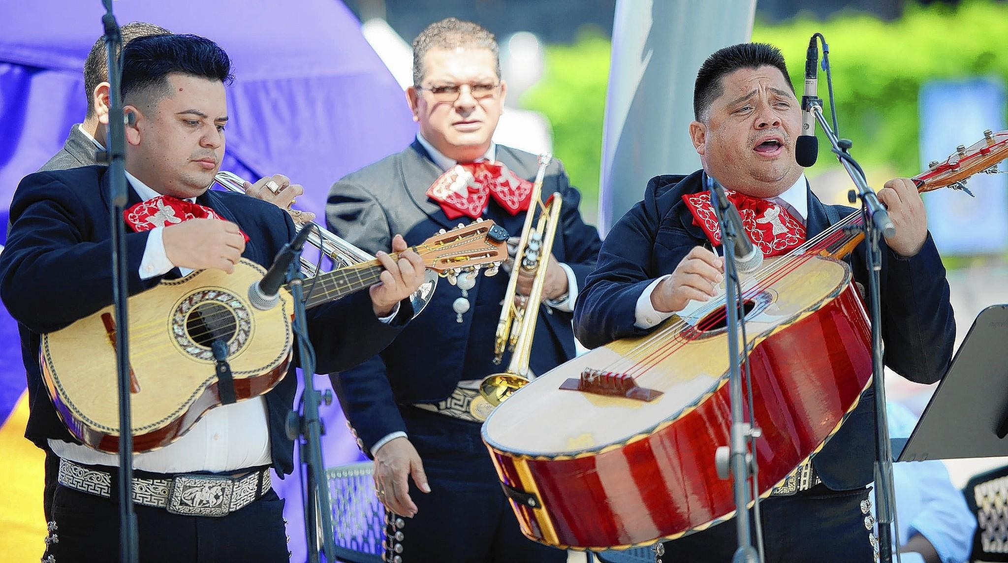 Mariachi Maya Internacional performs during a Mass on Sunday, the final day of the three-day Sabor Latin Festival at the Air Products Town Square at SteelStacks. The festival included free concerts and lots of ethnic food throughout the weekend.