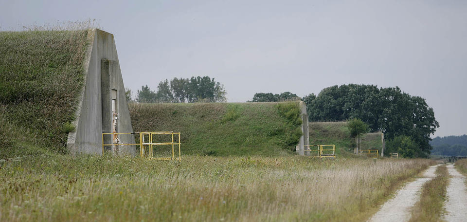 <b>Sept. 1, 2006:</b> A row of former TNT storage bunkers at the USDA (United States Dept. of Agriculture) Forest Service's Midewin National Tallgrass Prairie remain on the site of the former Joliet Arsenal. Most of the 392 bunkers on the site were to be torn down.