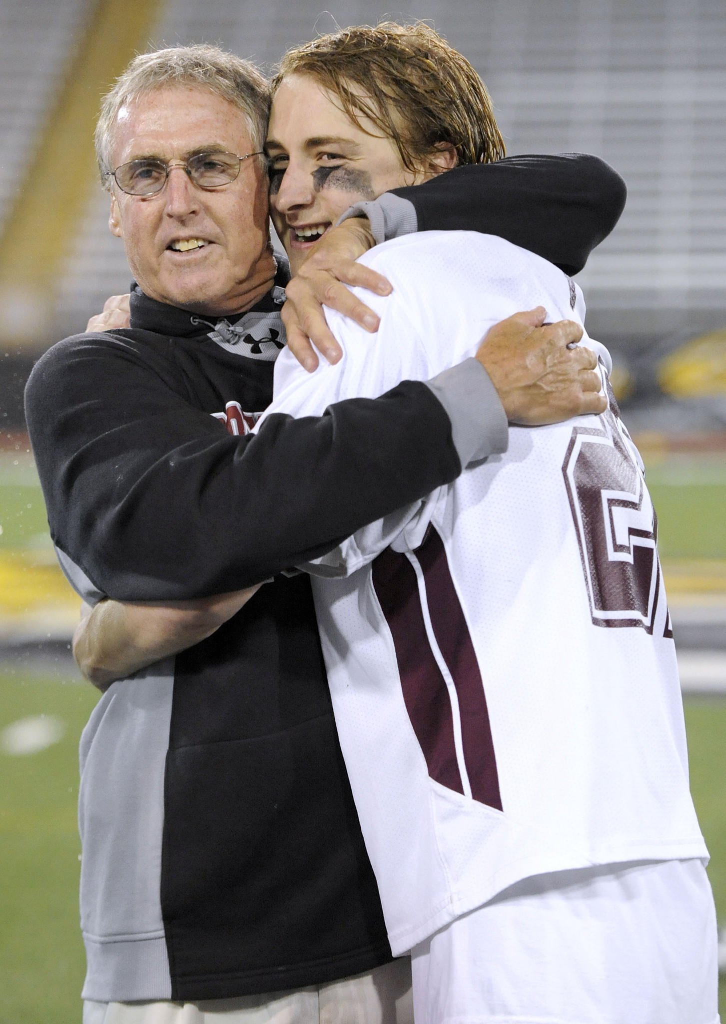 Boys' Latin lacrosse coach Bob Shriver, left, and senior attackman Colin Chell celebrate their 17-11 win against St. Paul's in the MIAA A Conference lacrosse championship Friday, May 15, 2014 in Towson.