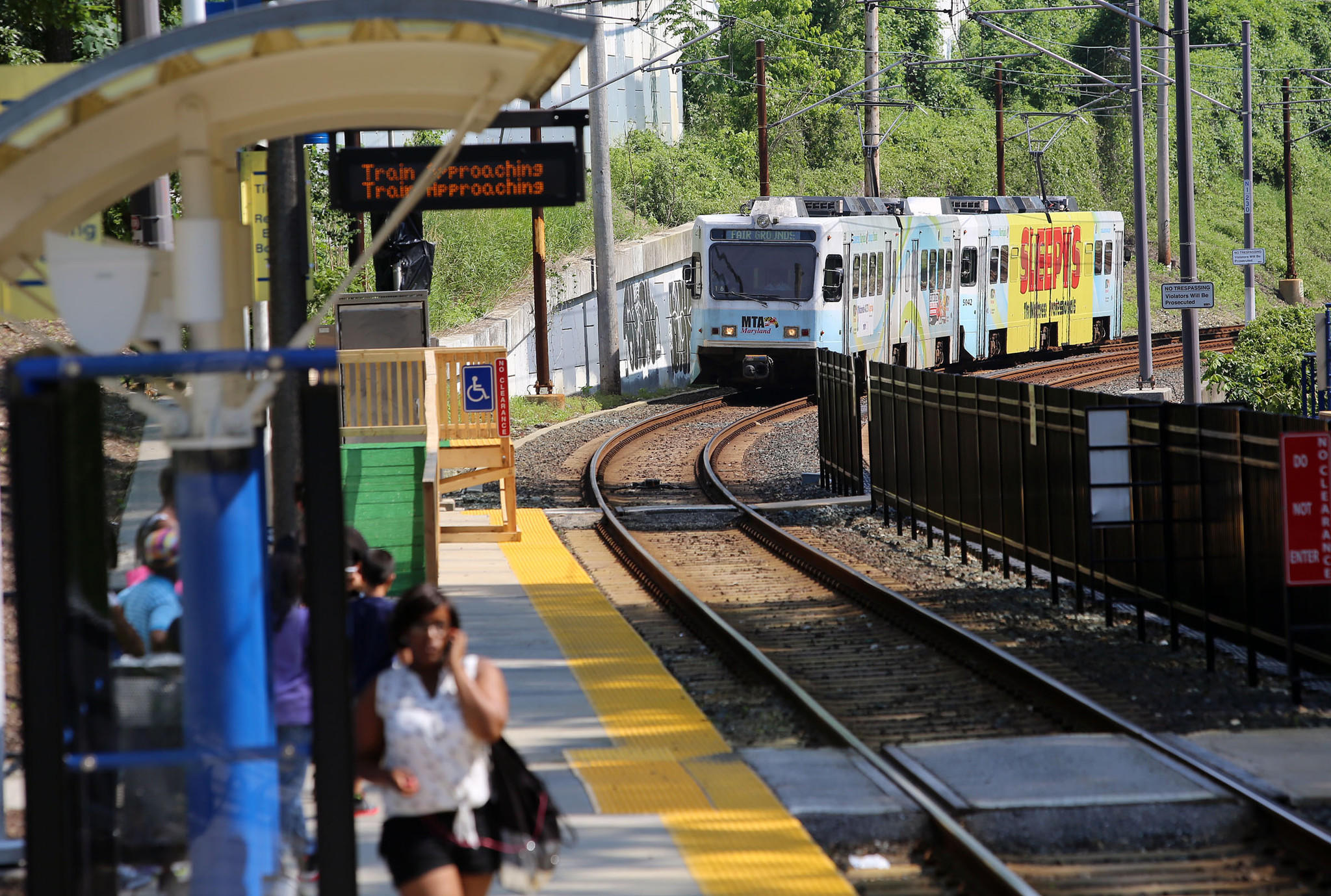 Baltimore, MD 6/18/14-An MTA light rail approaches the station at the Cold Spring Lane light rail stop Wednesday afternoon. Both northbound and southbound trains alternated running on a single track due to one track being closed for erosion repair. Al Drago/Baltimore Sun--#