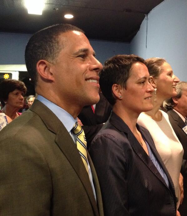 Anthony Brown and Heather Mizeur, once opponents, stand side by side at the Democratic unity rally.