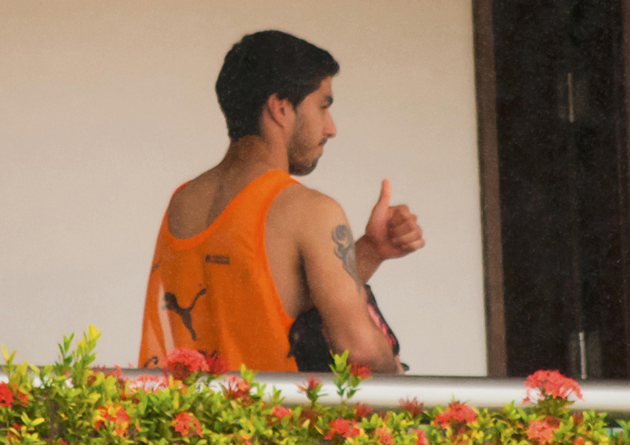 Uruguay's Luis Suarez gives a thumbs-up from a balcony of the team's hotel in Natal, Brazil, on Thursday.