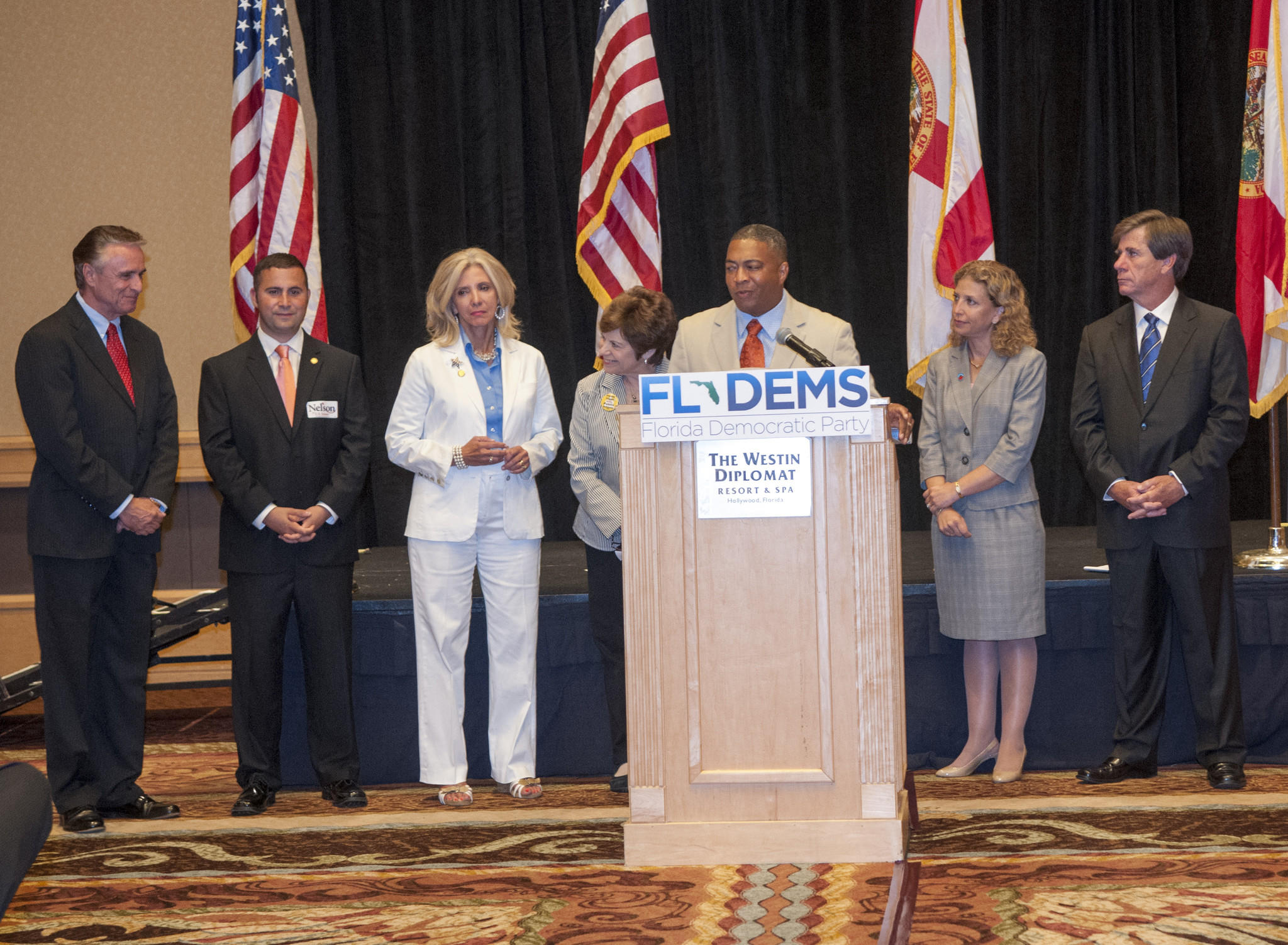 Candidates from left, Frank Bruno, Darren Soto, Maria Sachs, are introduced by then-Senate Minority Leader Nan Rich and Senator Chris Smith as Debbie Wasserman Schultz and then-Florida Democratic Party Chairman Ron Smith look on at a press conference before the Florida Democratic Party Jefferson Jackson Dinner at the Westin Diplomat Hotel in Hollywood.