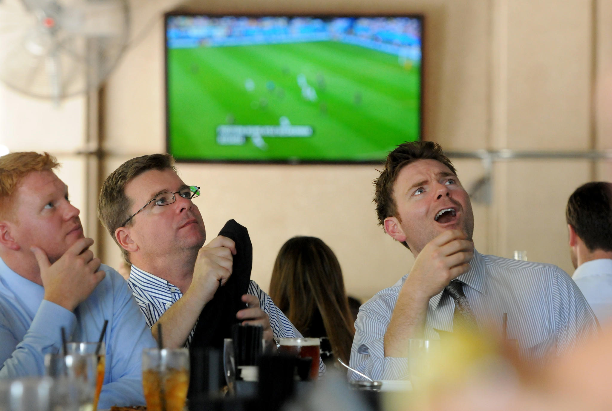 During their work lunch break, co-workers (left to right) Griffin McGuirt, Doug Griffin and Brandon Driscoll watch the US versus Germany FIFA World Cup game Thursday at the Royal Pig Pub & Kitchen on Las Olas Blvd. With over 27 televisions showing the US vs. Germany game, the Royal Pig was packed with employees from businesses surrounding the pub. Taimy Alvarez, Sun Sentinel