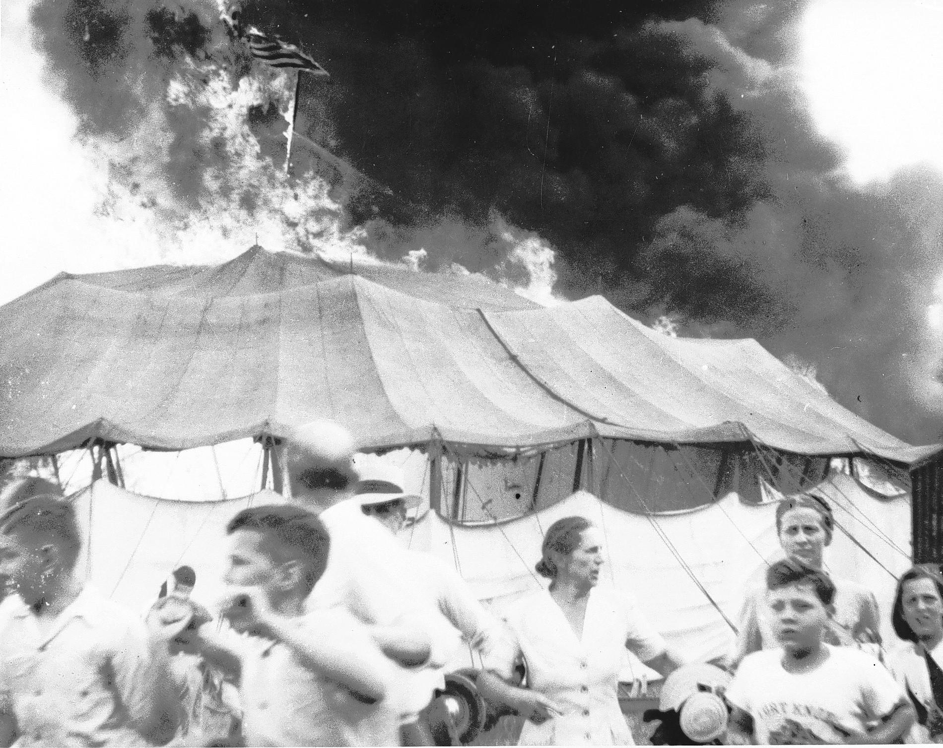 Terrified circus goers flee the raging fire on the afternoon of July 6, 1944.