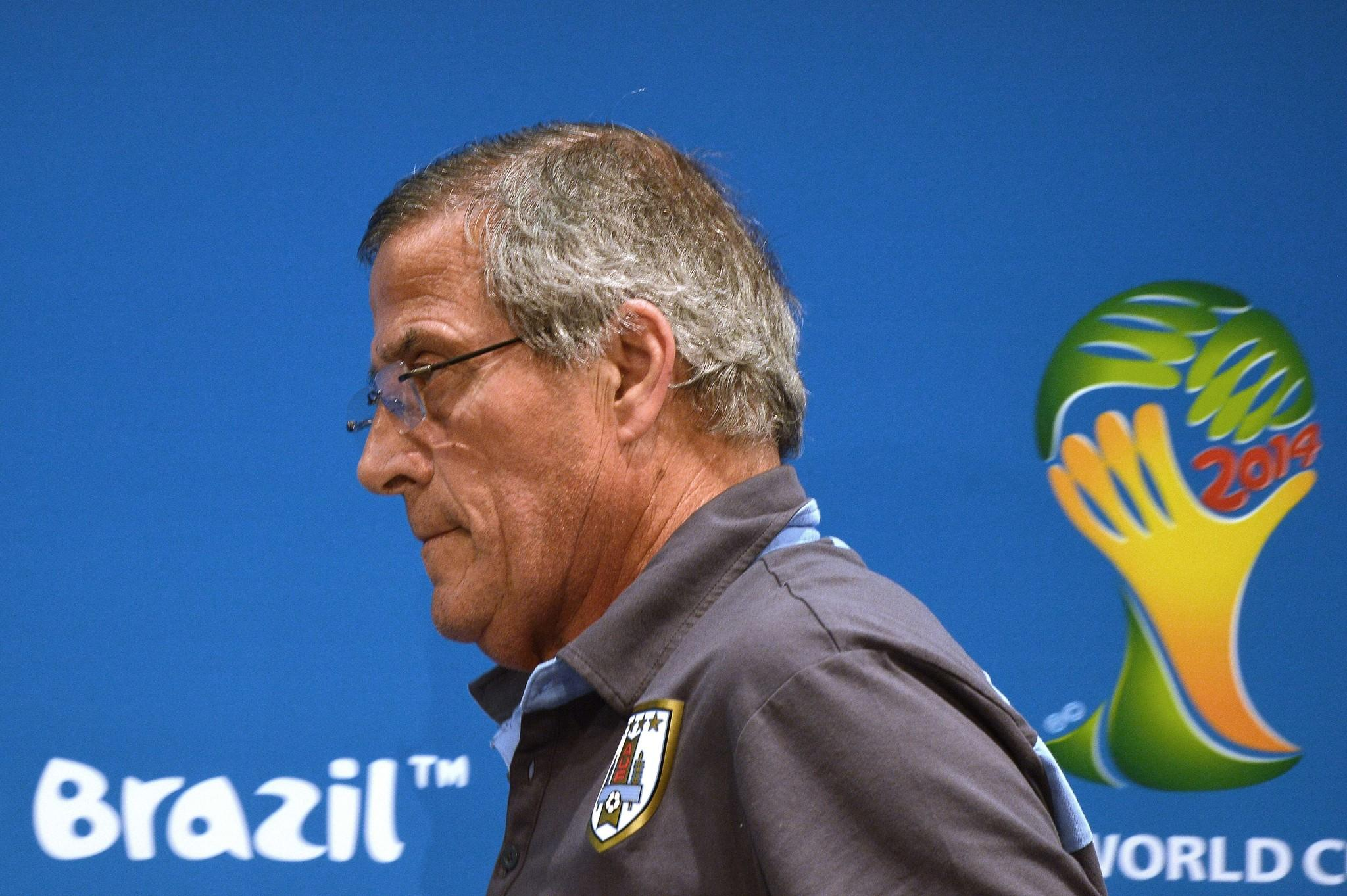 Uruguay's coach Oscar Tabarez walks after a press conference Friday.