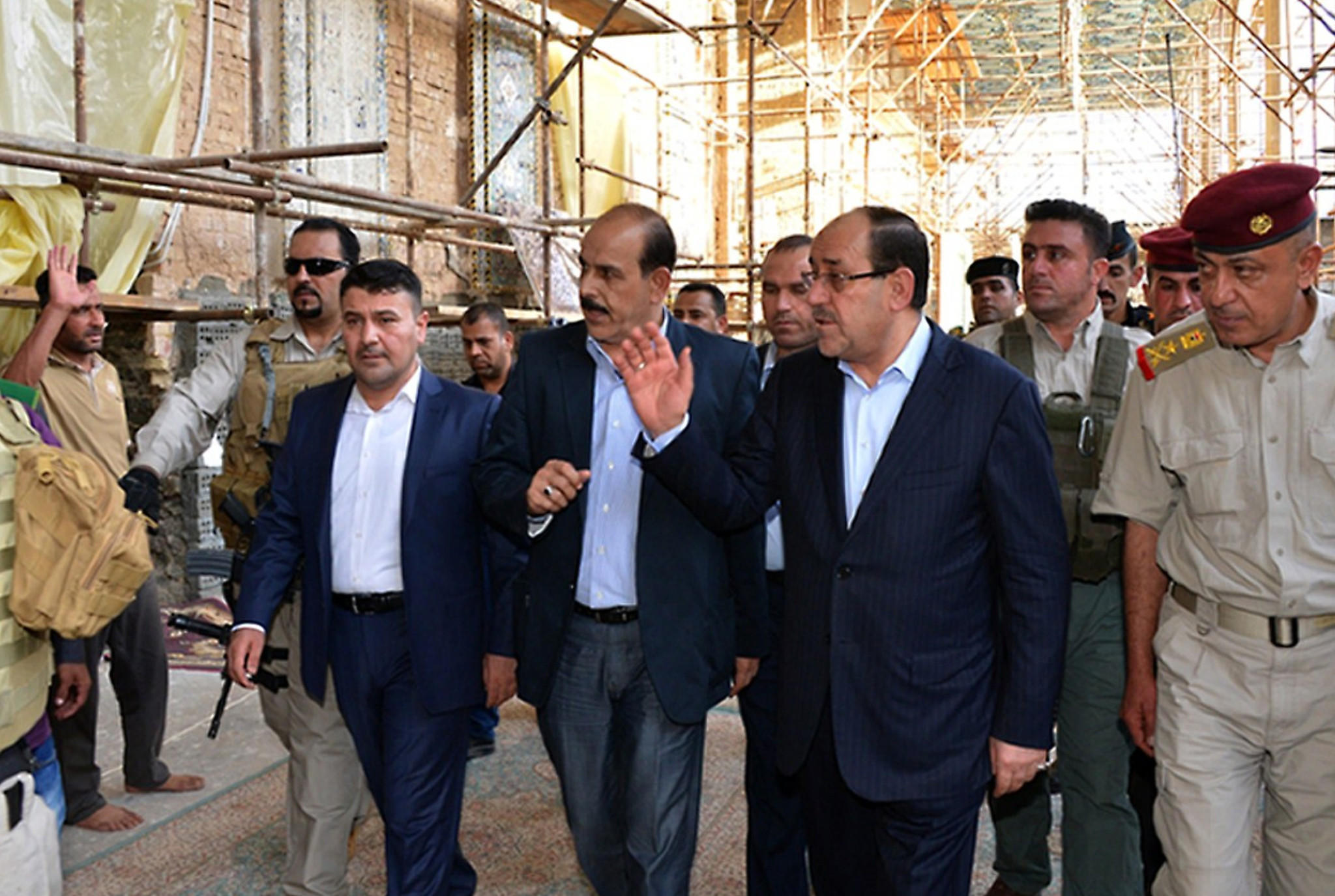 A handout picture released by the Iraqi Prime Minister's media office shows Iraqi Prime Minister Nuri al-Maliki, center, during a visit to the embattled city of Samarra on June 13, 2014.