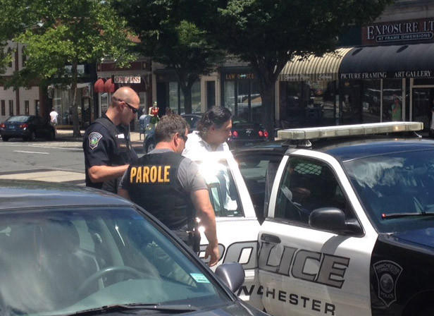 Rafael Cruz being placed in cruiser on Main Street in Manchester. Police arrested Cruz on several drug charges.