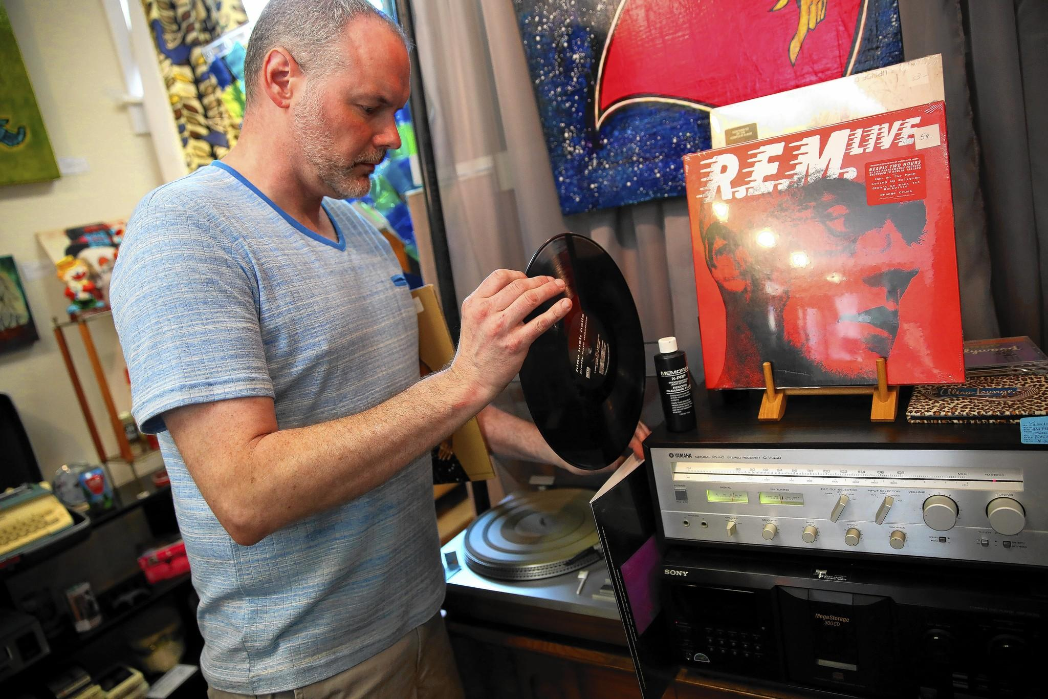 John Arnsdorff opened his record store, Audio Archaeology, in March in the Edgewater neighborhood. He sells new and used vinyl records and record players.
