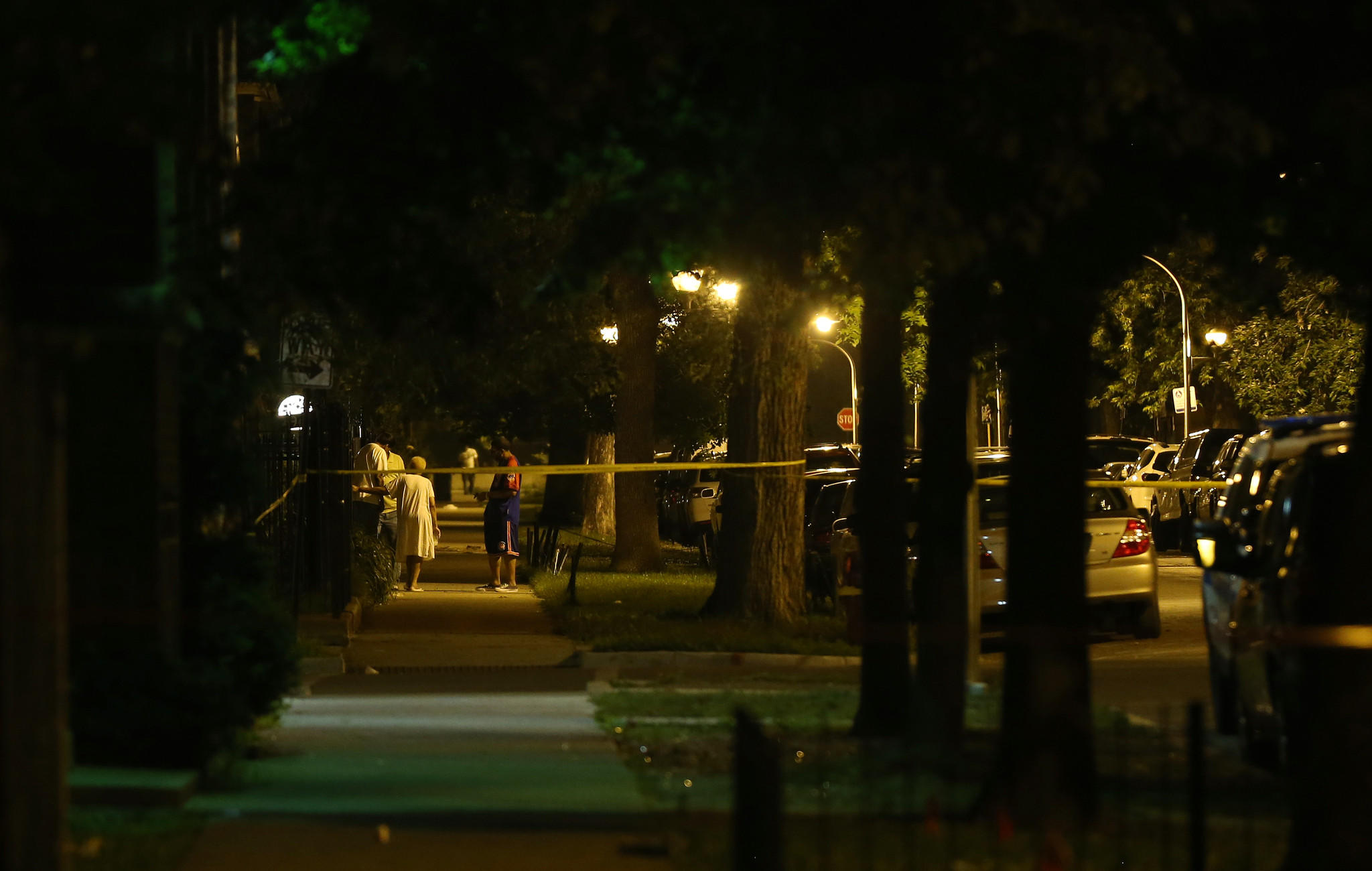 Crime scene tape keeps residents from the 5000 block of West Monroe Street following a police-involved shooting early Saturday, in Chicago.