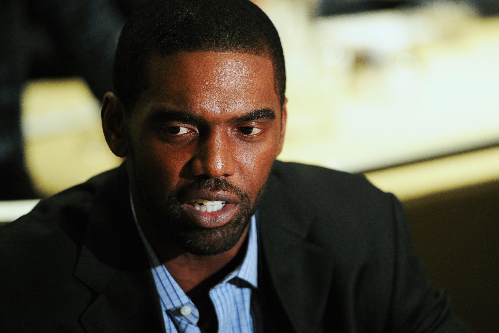 Randy Moss, former NFL player and current NFL analyst for FOX Sports, answers questions from the press during the FOX Sports media availablility in the Empire East Ballroom, at Super Bowl XLVIII Media Center at the Sheraton New York Times Square on January 28, 2014 in New York City.