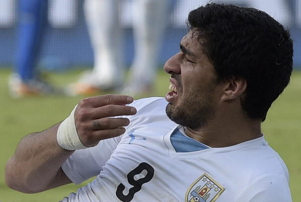 Uruguay forward Luis Suarez reacts after clashing with Italy's defender Giorgio Chiellini during a Group D football match between Italy and Uruguay at the Dunas Arena in Natal during the 2014 FIFA World Cup on June 24, 2014. Uruguay won 1-0.