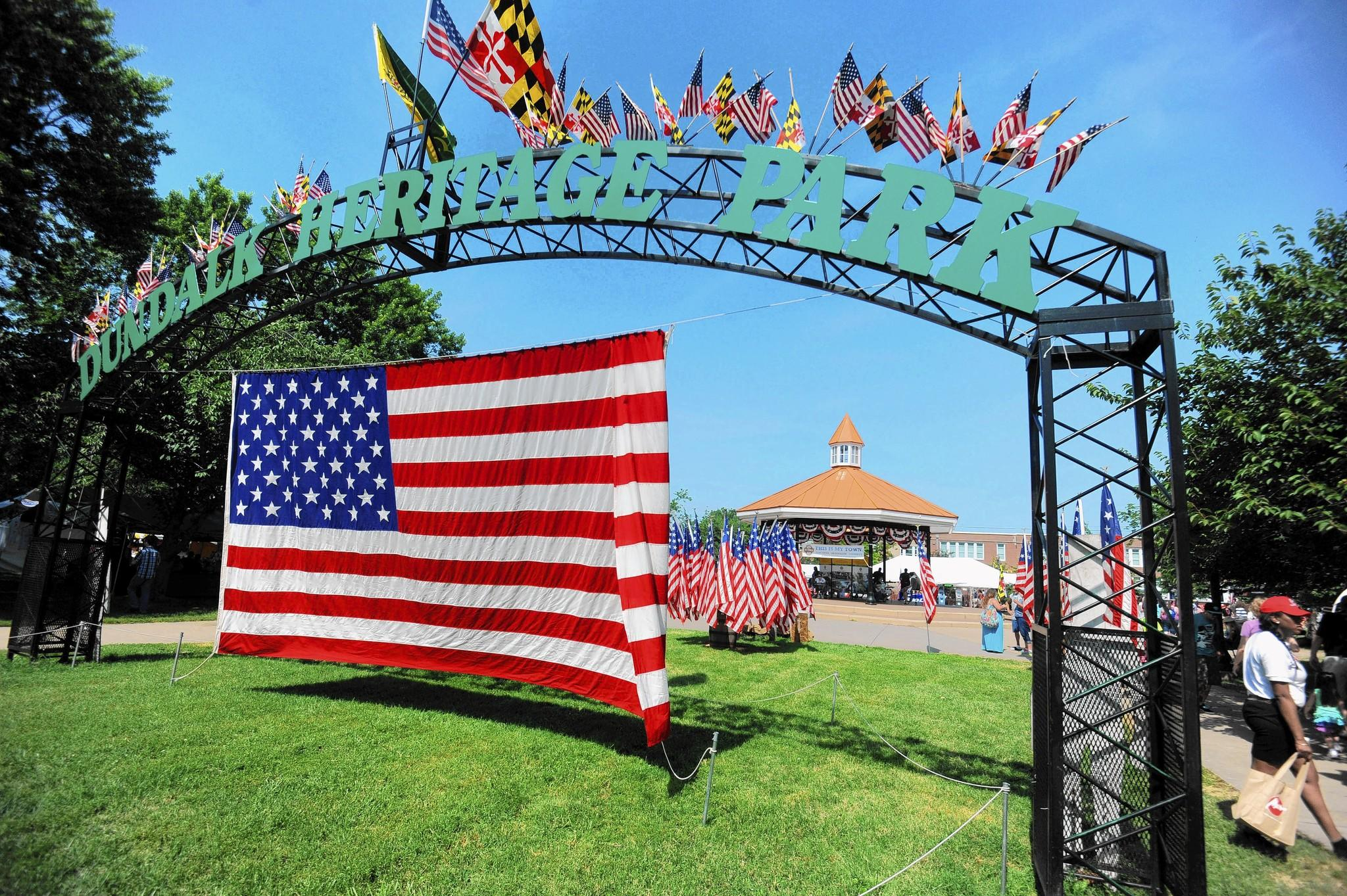 American flags greet visitors entering the Dundalk Heritage Fair at Dundalk Heritage Park.