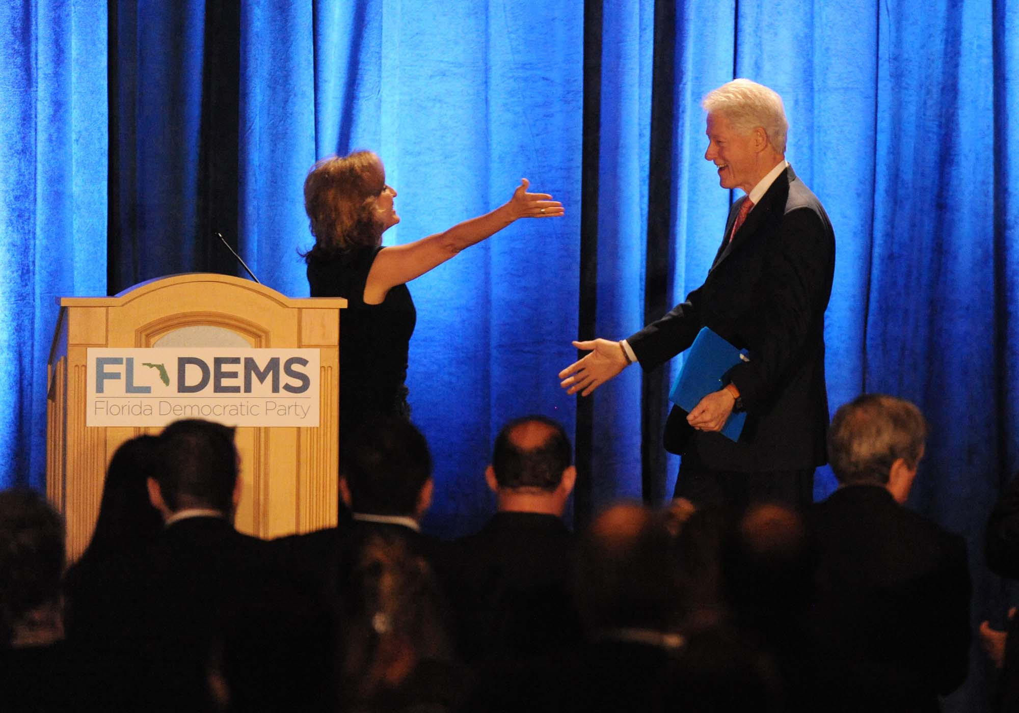 President Clinton is welcomed to the stage by Florida Democratic Chairwoman Allison Tant at the Florida Democratic Party's big annual gathering held at the Westin Diplomat in Hollywood. Jim Rassol, Sun Sentinel. 6/28/2014.