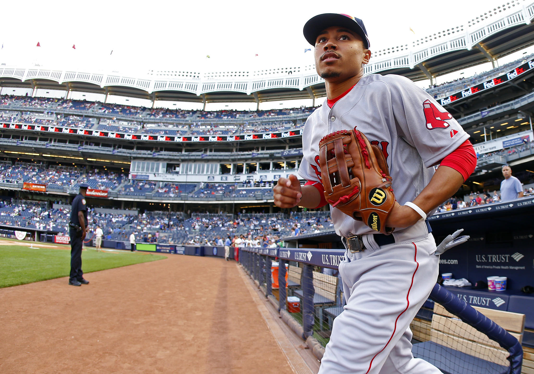 Mookie Betts takes the field for the Red Sox before the start of a game against the Yankees at Yankee Stadium on Saturday.