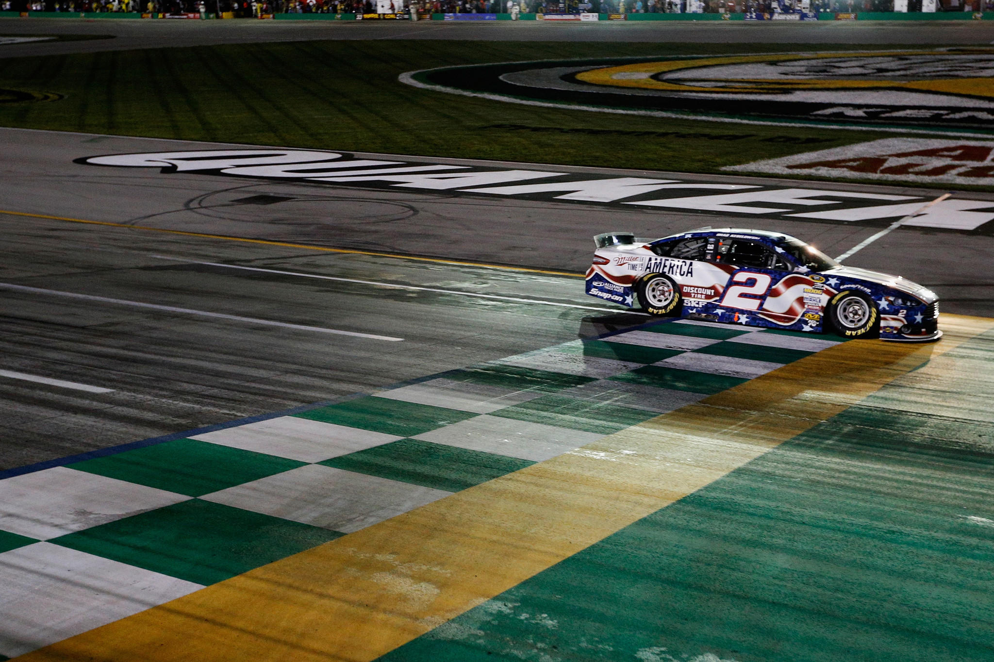 Brad Keselowski, driver of the #2 Miller Lite Ford, takes the checkered flag to win the NASCAR Sprint Cup Series Quaker State 400 presented by Advance Auto Parts at Kentucky Speedway.