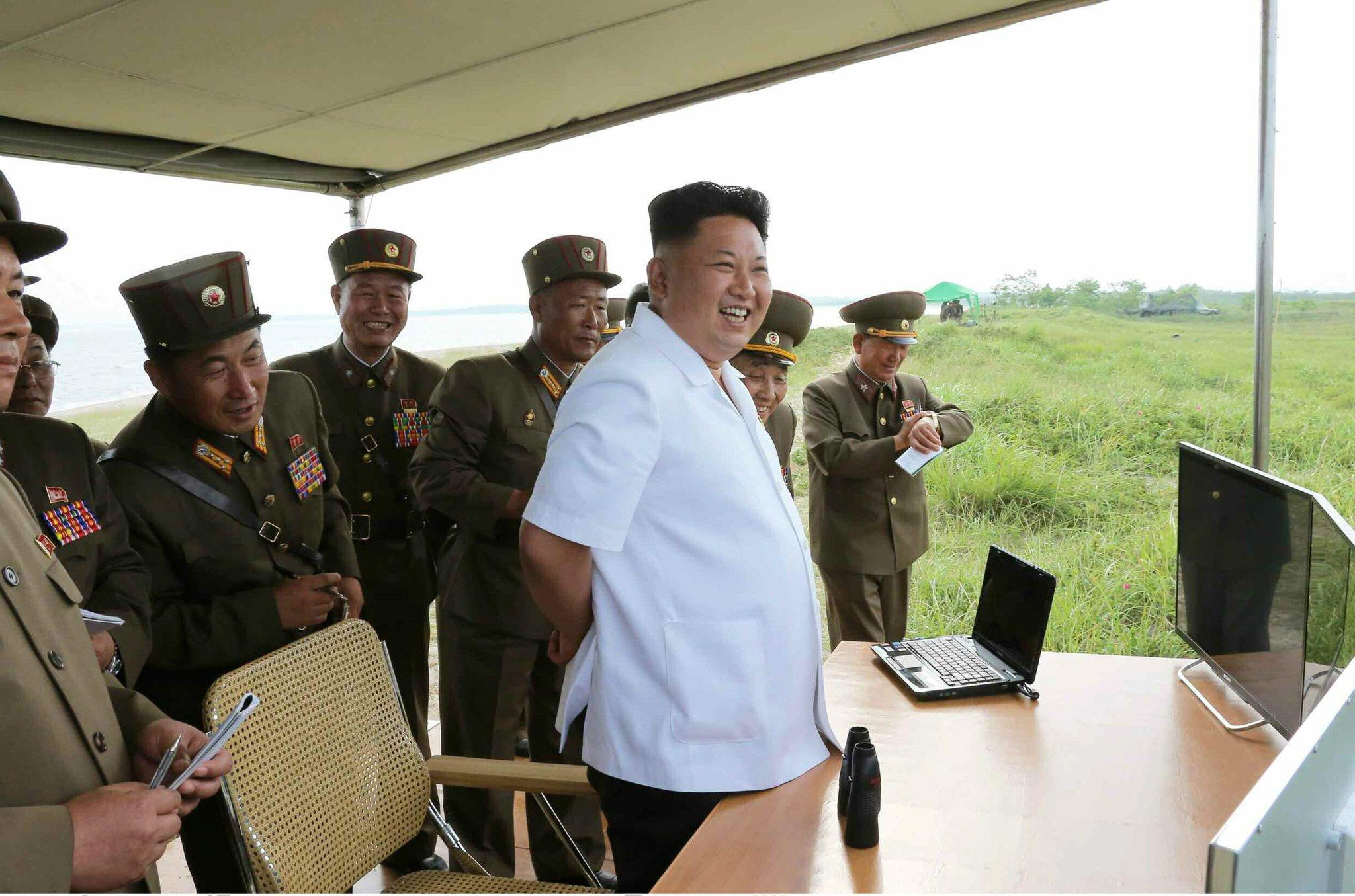 A picture released by the Rodong Sinmun, the newspaper of the ruling North Korean Workers Party, on 27 June 2014 shows North Korean leader Kim Jong-un observing the test-fire of a newly developed tactical guided missile at an undisclosed location in North Korea.