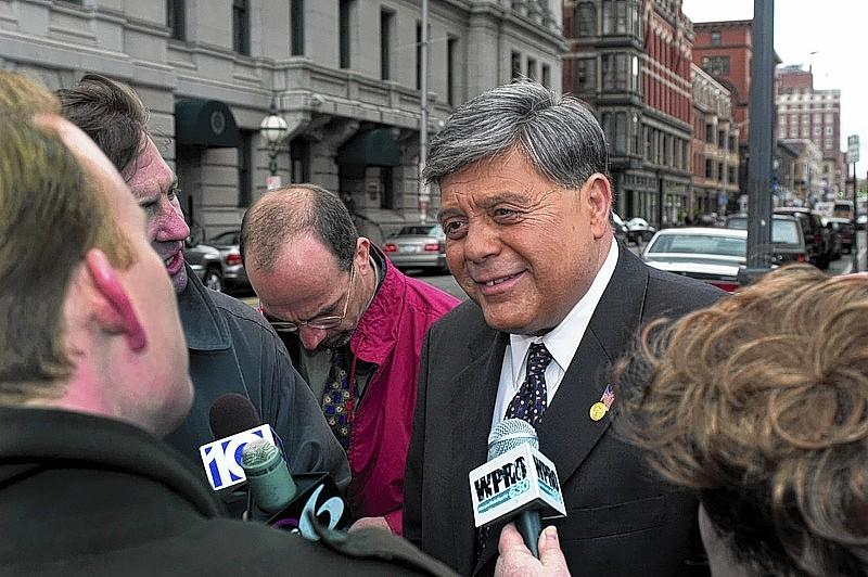 "Providence Mayor Vincent A.""Buddy"" Cianci Jr. talks with reporters as he leaves the Biltmore Hotel, across from City Hall, on his way to federal court on April 23, 2002, where the prosecution outlined its case against him. He is charged with racketeering, conspiracy, extortion, mail fraud and witness tampering in the ""Plunder Dome"" scandal."