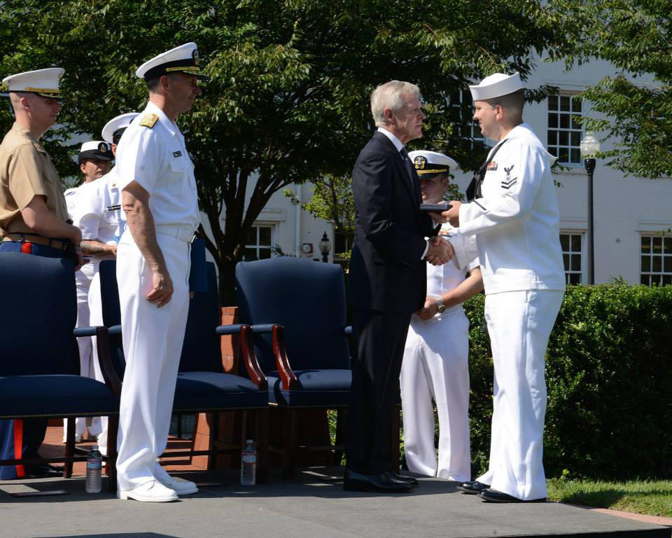 Charles Pitt, right, receives a Navy and Marine Corps Medal from Secretary of the Navy Ray Mabus for his role in responding to the Navy Yard shooting incident last year in Washington. Photo courtesy U.S. Navy