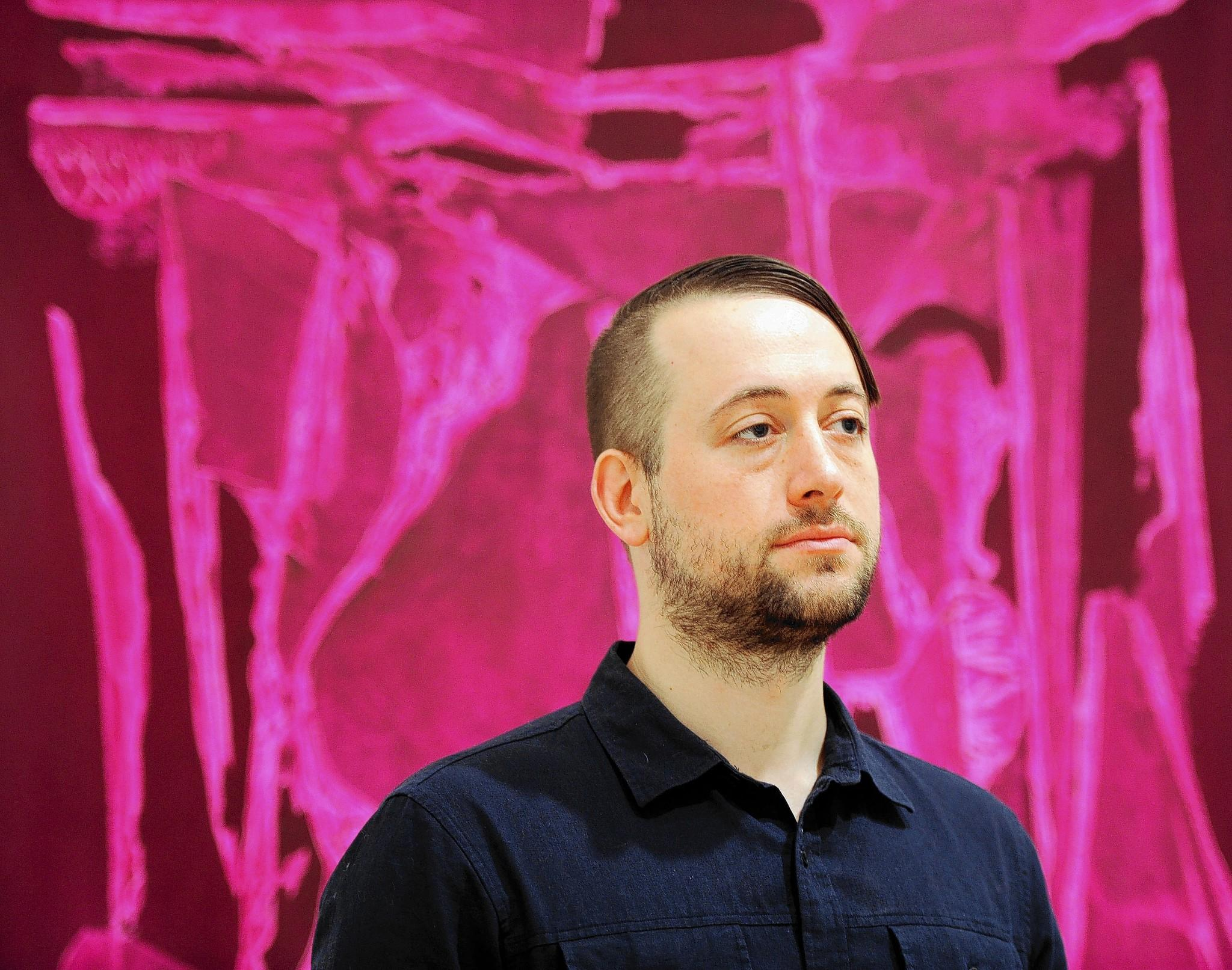Seth Adelsberger, a local artist, has several pieces on exhibit at the Baltimore Museum of Art. Behind him is Submersion Painting, acrylic and gesso on canvas mounted to oak panel.