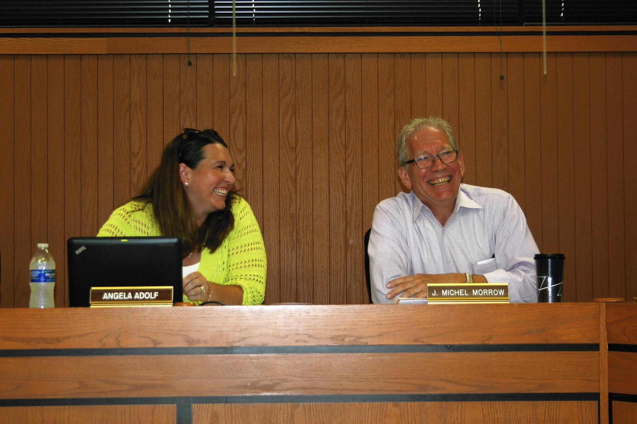 J. Michel Morrow shares a laugh with school board President Angela Adolf during his last meeting as superintendent of Homer Community Consolidated School District 33C.