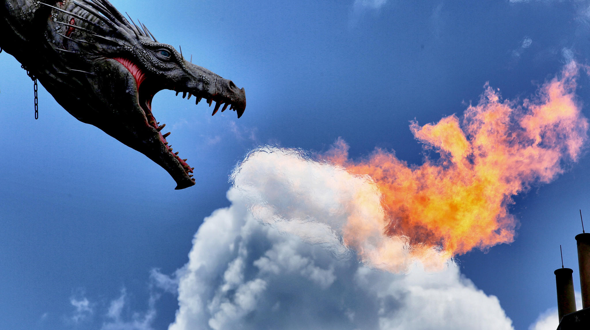 The dragon spews fire during the media preview at the Wizarding World of Harry Potter - Diagon Alley - Thursday, June 19, 2014, at Universal Studios Florida in Orlando. (Joe Burbank/Orlando Sentinel) B583808825Z.1
