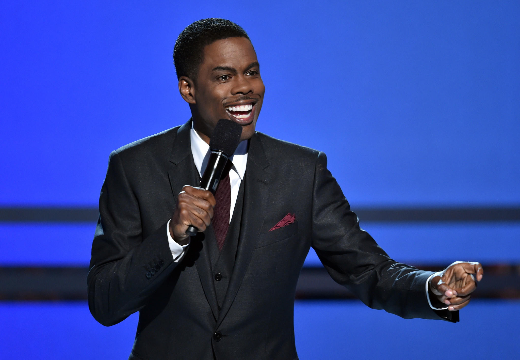 Host Chris Rock speaks onstage during the BET Awards '14 at Nokia Theatre in Los Angeles