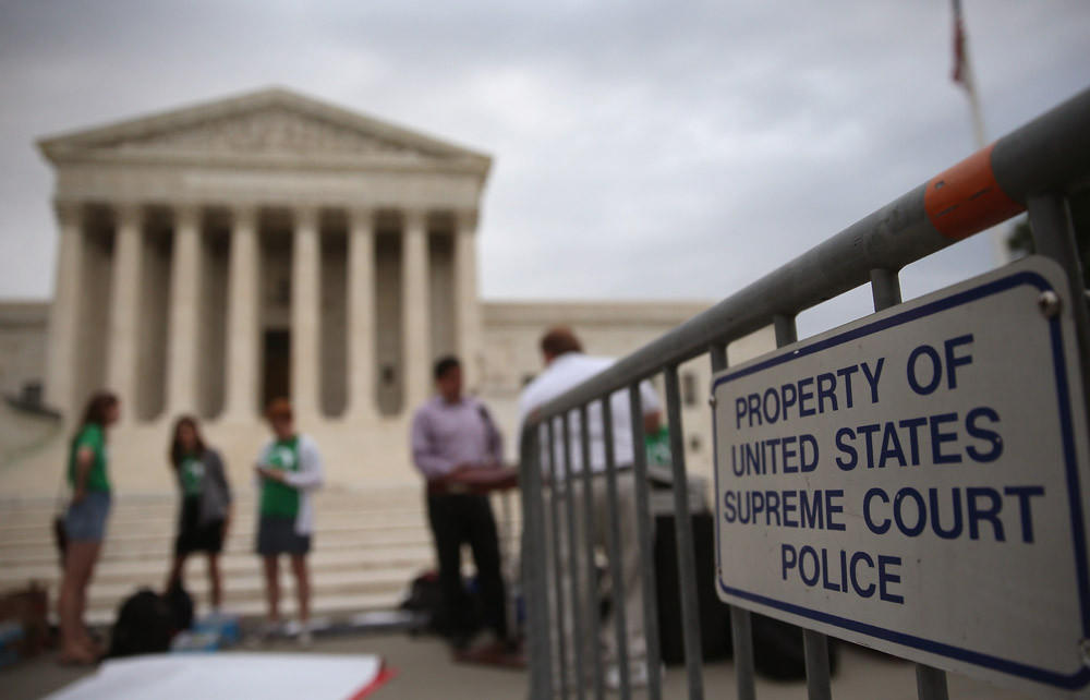People gather in front of the U.S. Supreme Court on June 30 in Washington, D.C.