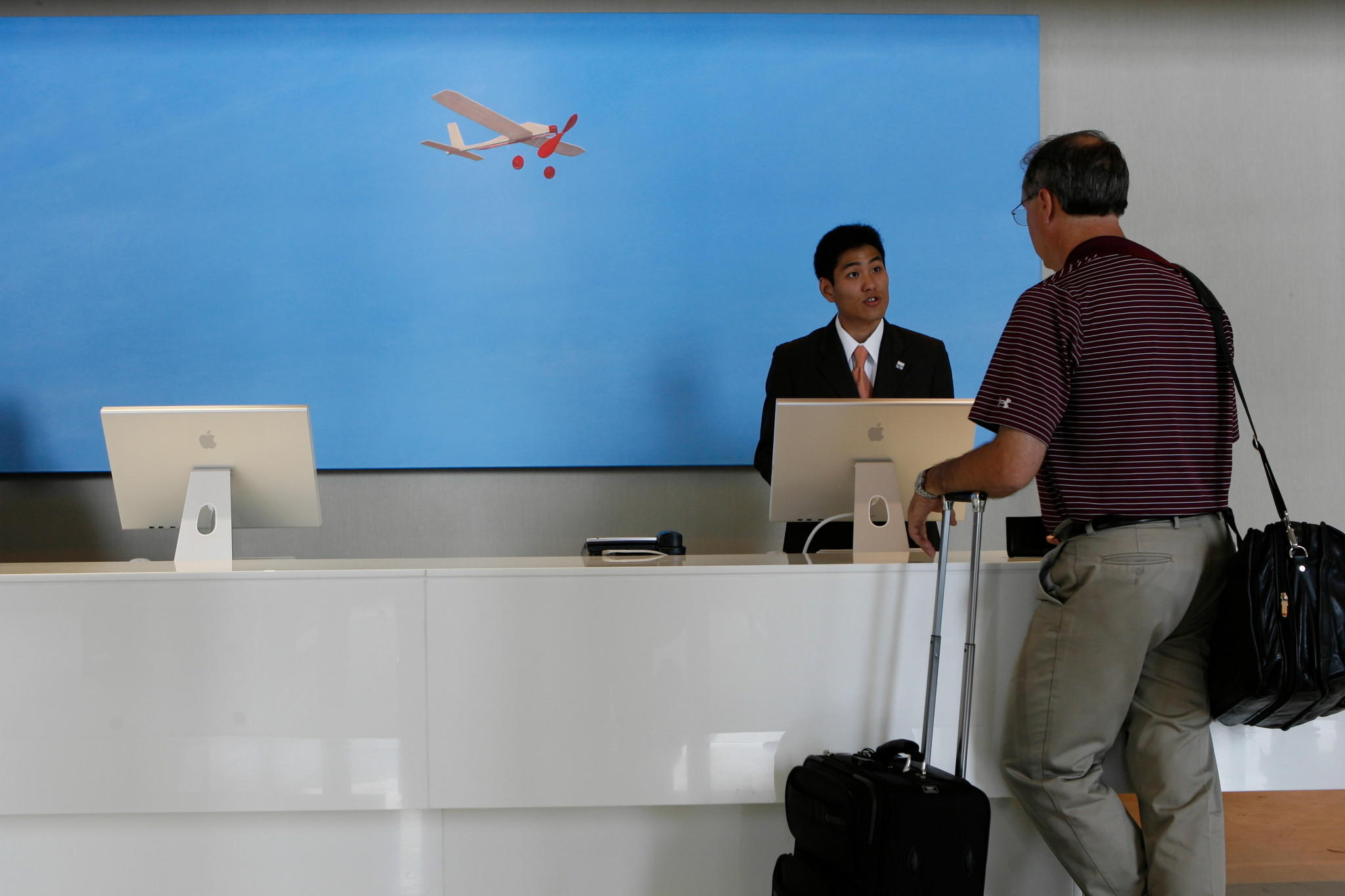 A guest, right, checks in at the reception desk Intercontinental Chicago O'Hare in Rosemont.
