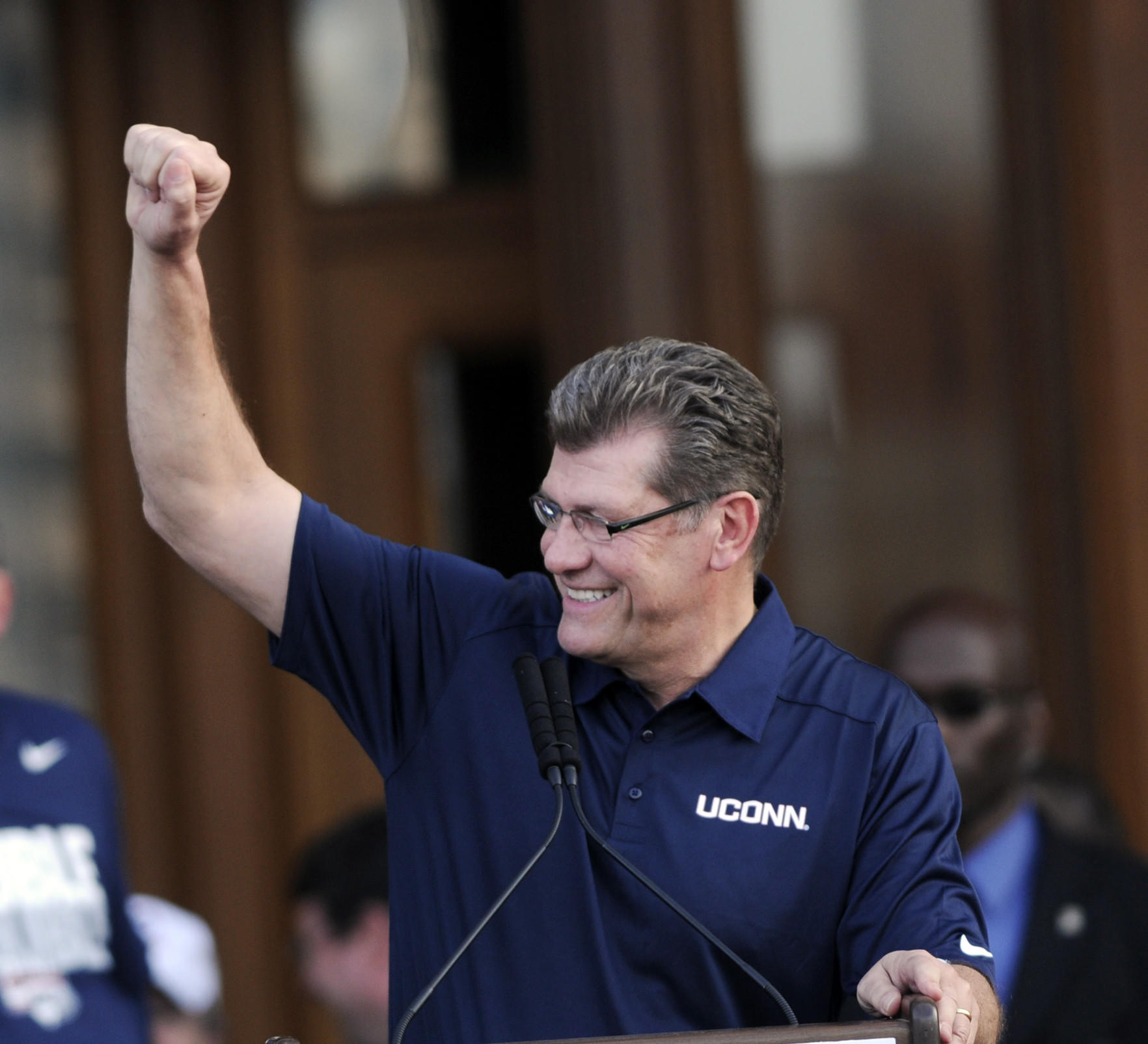HARTFORD- 4/13/14- hc-photo-uconn-parade-0414- UCONN women's coach Geno Auriemma saluted the thousands gathered for a rally at the State Capitol Sunday following the Dual parade for both championship teams. STEPHEN DUNN|sdunn@courant.com