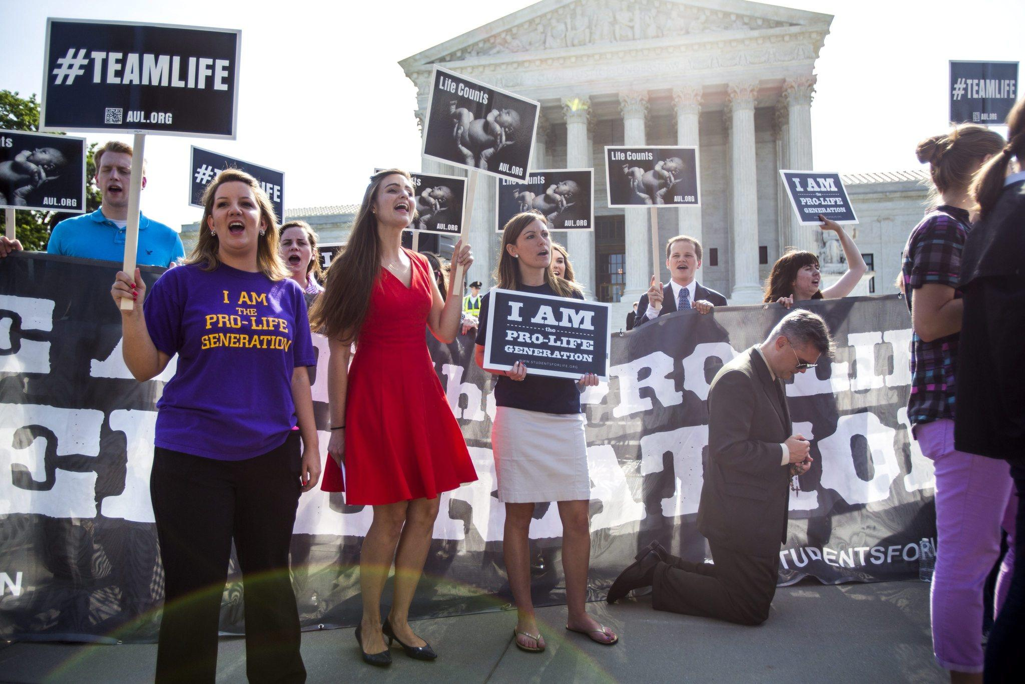 Pro-life protestors gather outside the U.S. Supreme Court where the nine justices are expected to issue their ruling on the Hobby Lobby case, which challenges the Affordable Care Acts mandate that employee health plans include pregnancy preventive services, in Washington, DC
