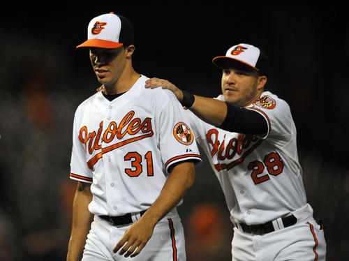 Orioles right-hander Ubaldo Jimenez, left, receives congratulations from first baseman Steve Pearce after the club's 7-1 win over the Texas Rangers at Camden Yards.