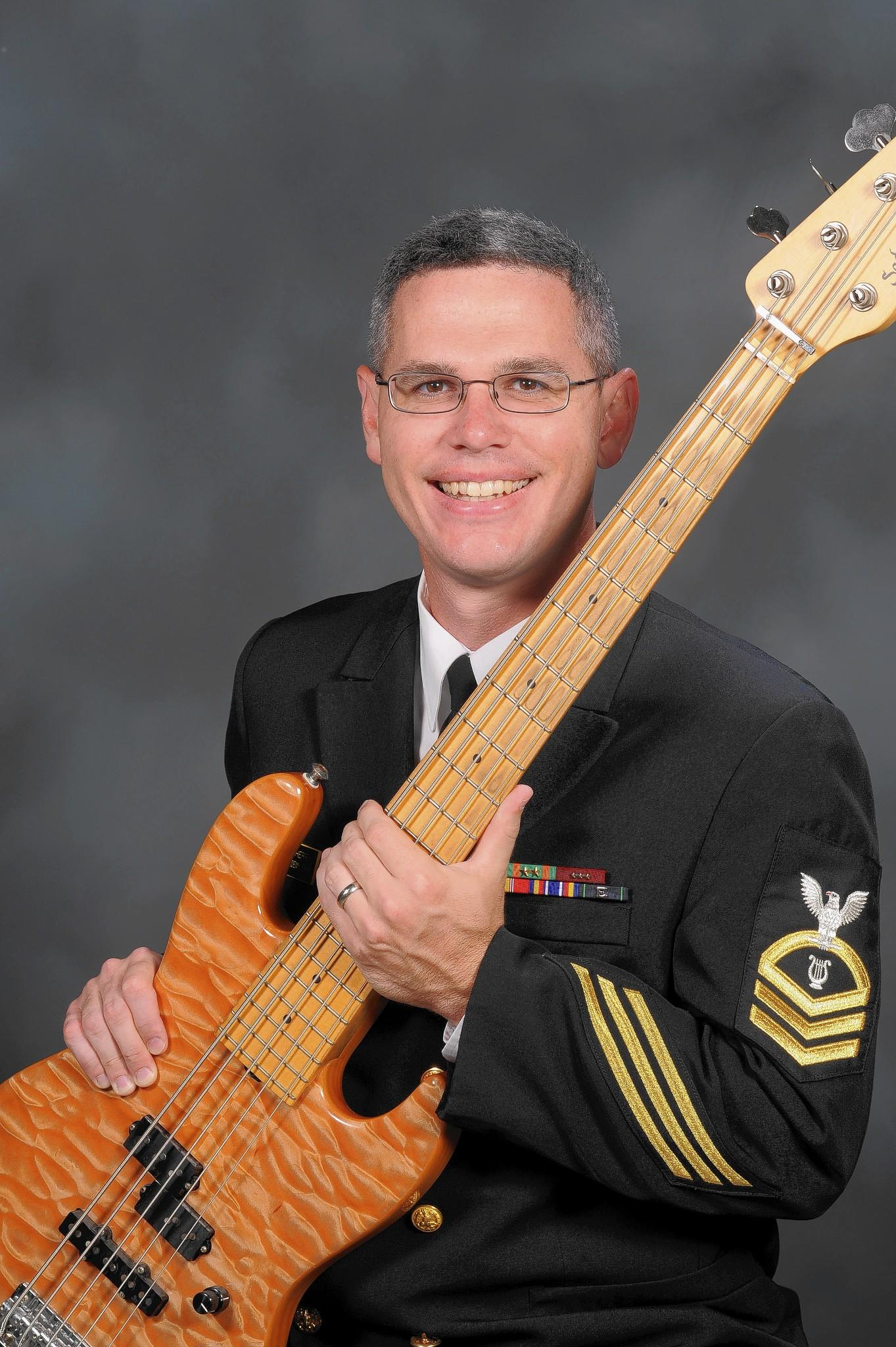 Rory Cherry, chief musician and electric bassist for the Electric Brigade, the U.S. Naval Academy Band.