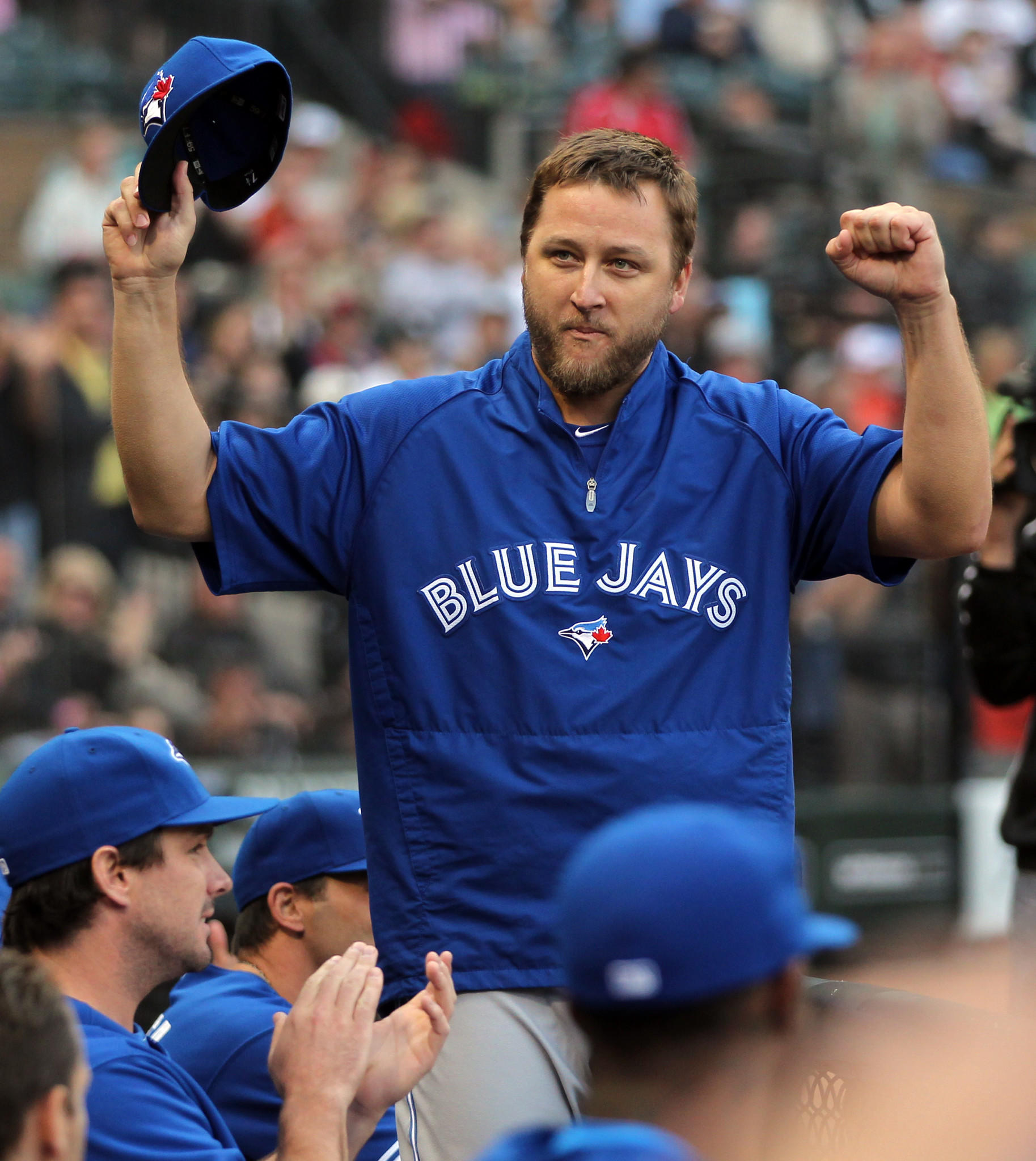 Former Chicago White Sox' pitcher and current Toronto Blue Jay Mark Buehrle acknowledges an ovation at U.S. Cellular Field last summer.