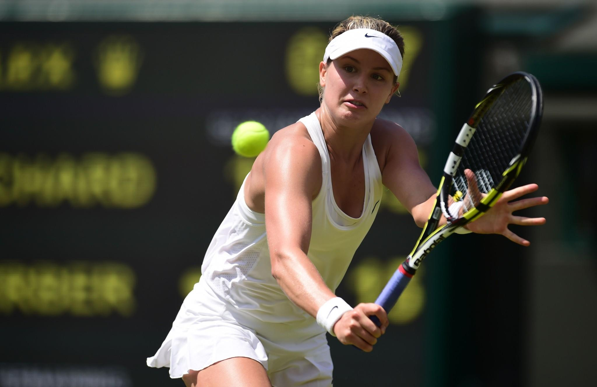 Eugenie Bouchard returns to Angelique Kerber during their women's singles quarterfinal match.