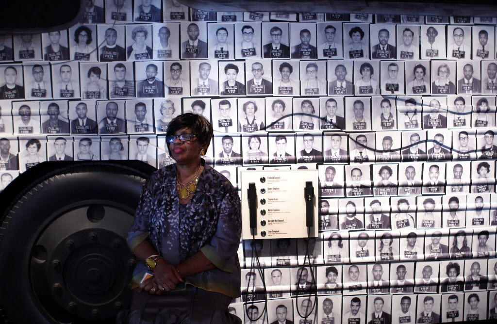 Freedom Rider Julia Aaron Humbles meets members of the media as she sits in front of an exhibit of mug shots of Freedom Riders at the new National Center for Civil and Human Rights in Atlanta, Georgia June 19, 2014. The museum opening on Monday links the U.S. civil rights movement in the 1950s and 1960s to modern fights for human rights across the world to give visitors new insight on how the struggles are related, organizers said.