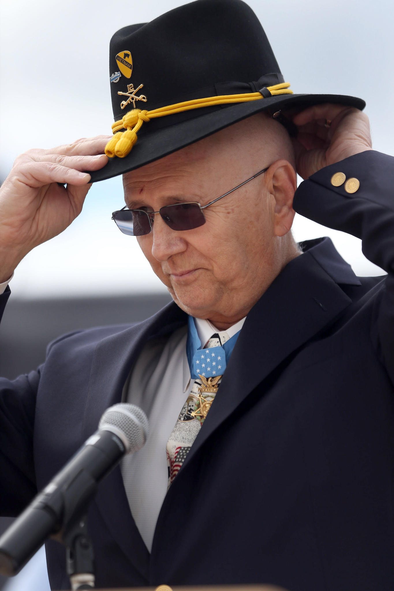 U.S. Army First Sgt. (retired) Allen J. Lynch adjusts his First Cavalry hat.