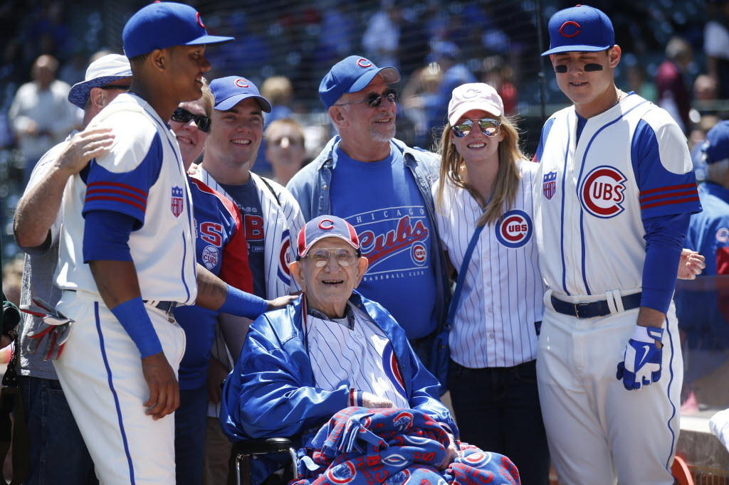 Louis Reinhart, a retired farmer from Metamora, poses for a photograph with his family and Cubs Starlin Castro left, and Anthony Rizzo, right, on June 8.