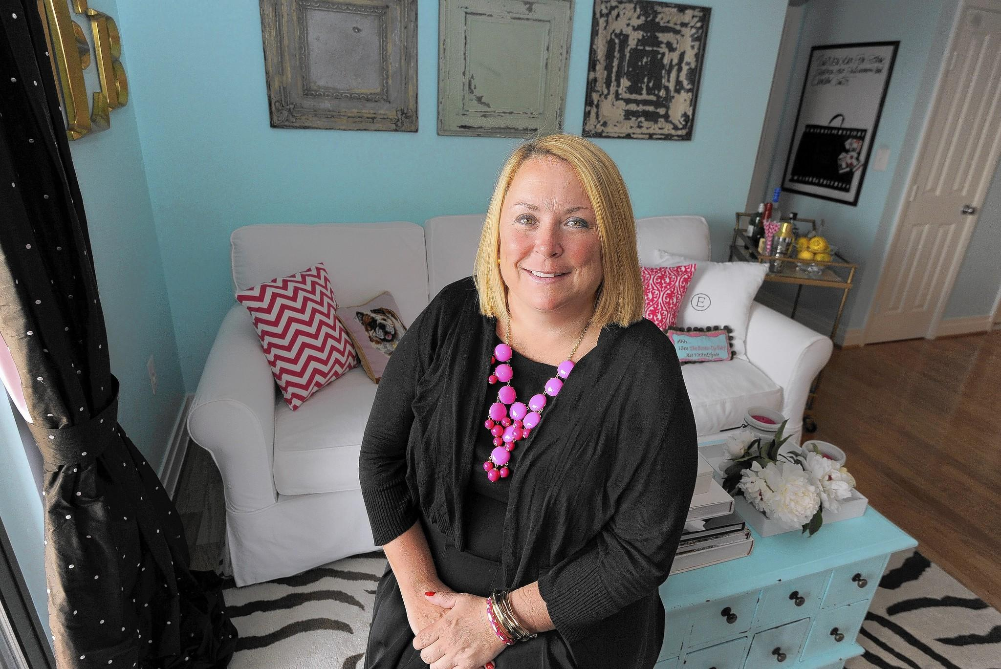 Baltimore, MD-6/19/14-Jennifer Etheridge is pictured in the living room of her dream home. Algerina Perna/Baltimore Sun--#2418.