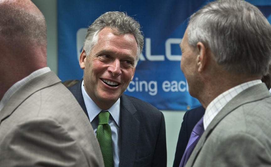 Gov. Terry McAilife talking with guests after the program ended. Alcoa's $25 Million expansion to their aerospace next-gen aircraft engine parts facility in Hampton. Gov. Terry McAuliffe and others were on hand in Hampton on today to make a economic development announcement of 75 (in three years) new jobs at Alcoa and an investment of $25 million in their operation in Hampton.