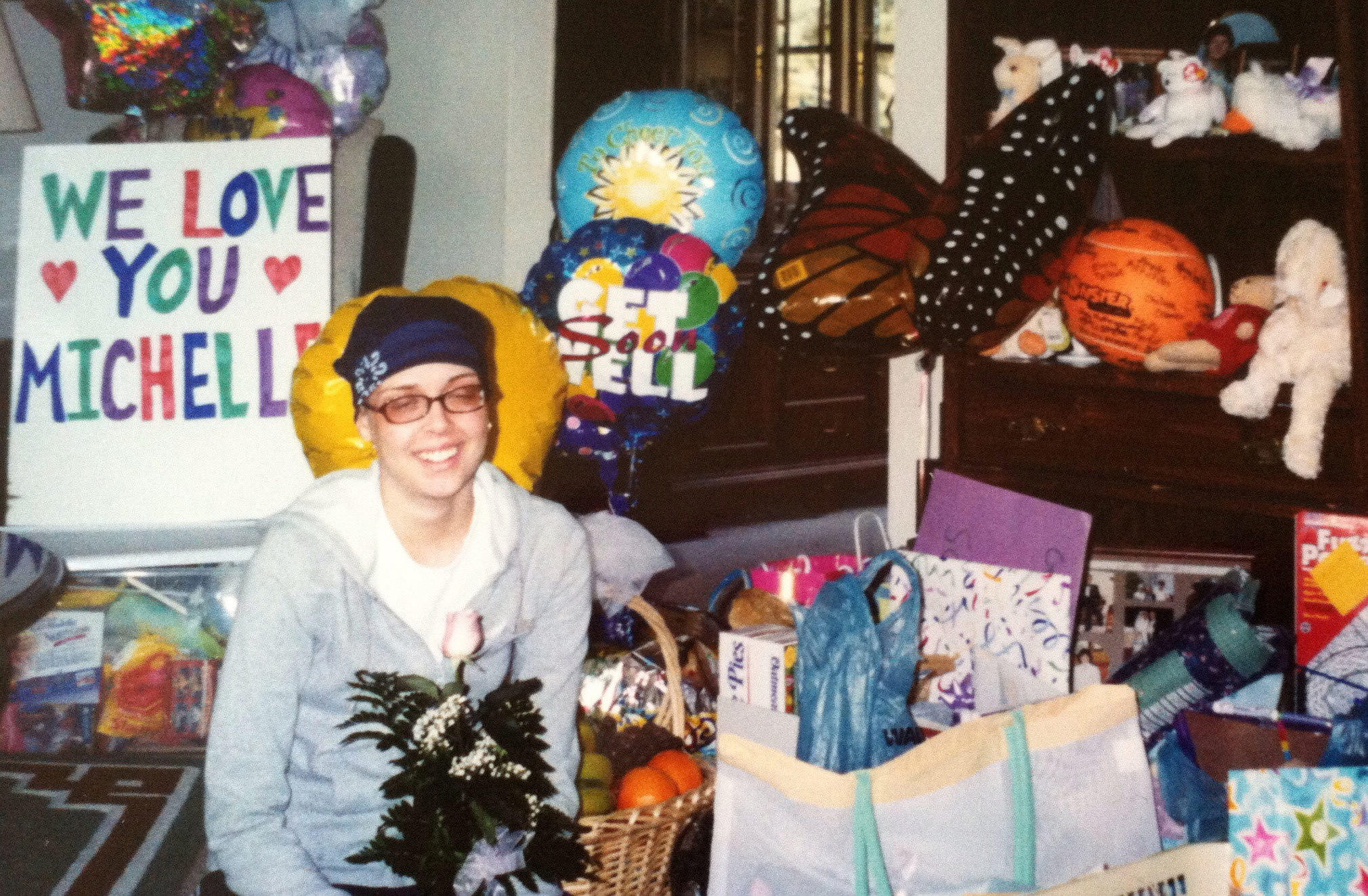 Michelle Manchir sits in her living room in Richmond, Ind., in March 2002, after getting home from her first inpatient hospital stay where she received chemotherapy.
