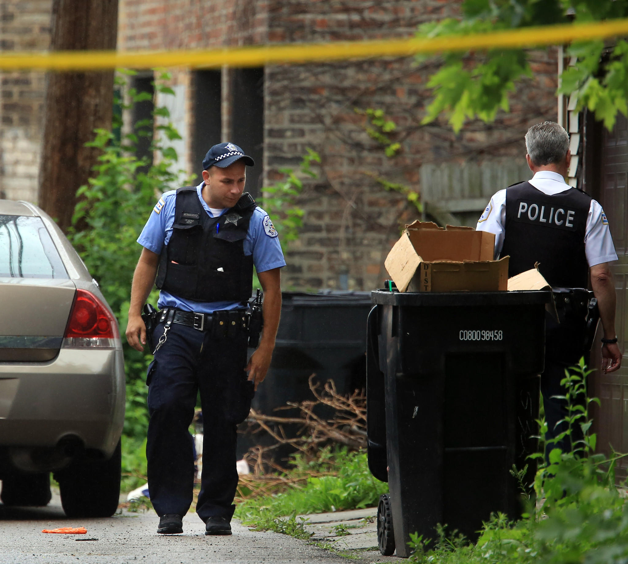 Chicago Police at the scene of a shooting Wednesday in the alley west of the 500 block of North Pine Avenue in Chicago.