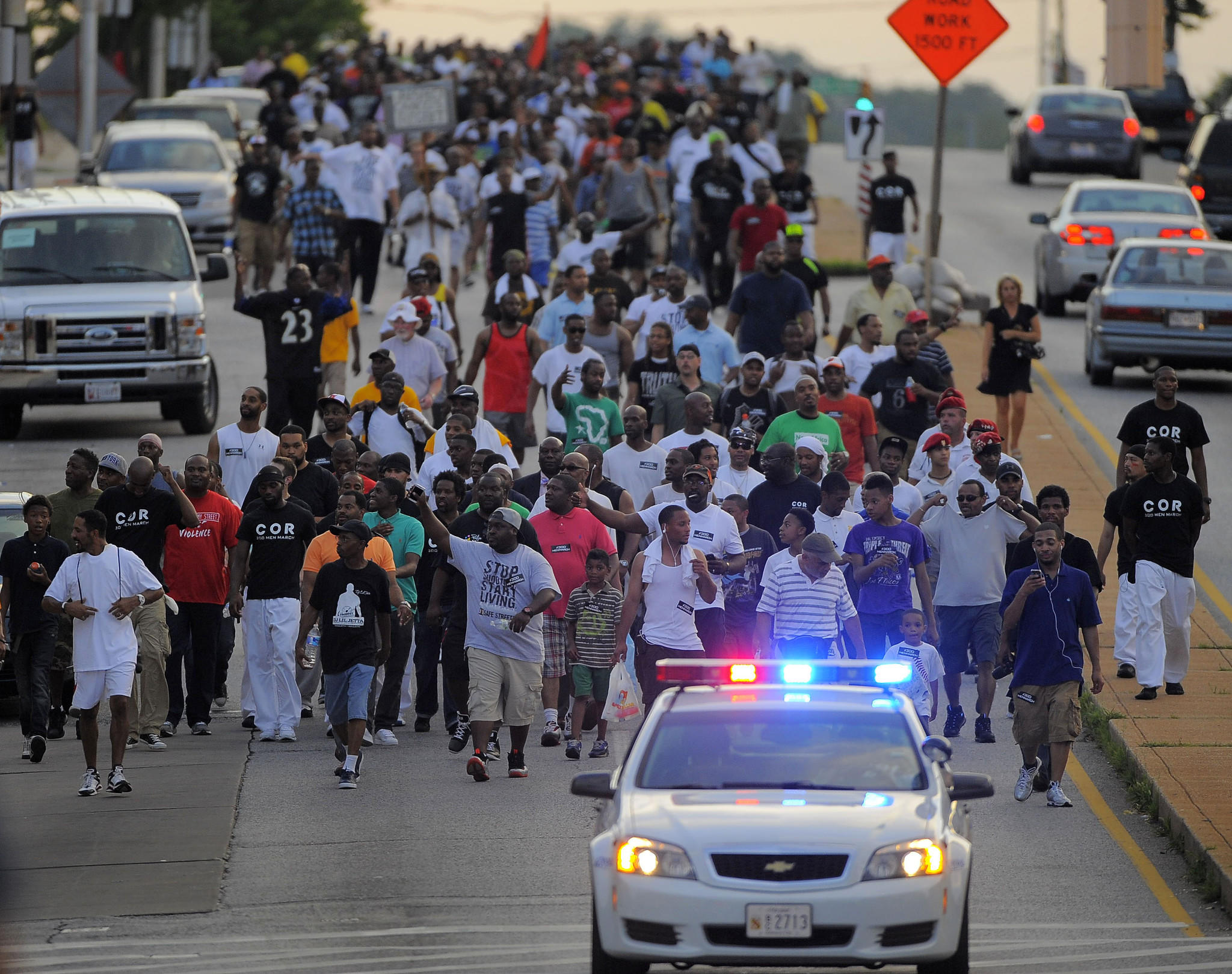 People march on North Avenue during a 300 Man March to speak out against violence in the city.