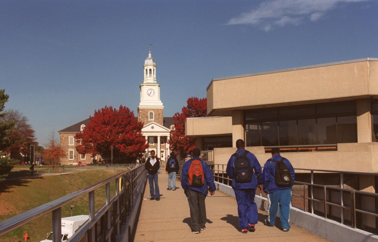 Students walk a pedestrian bridge at Morgan State in a 2002 file photo.