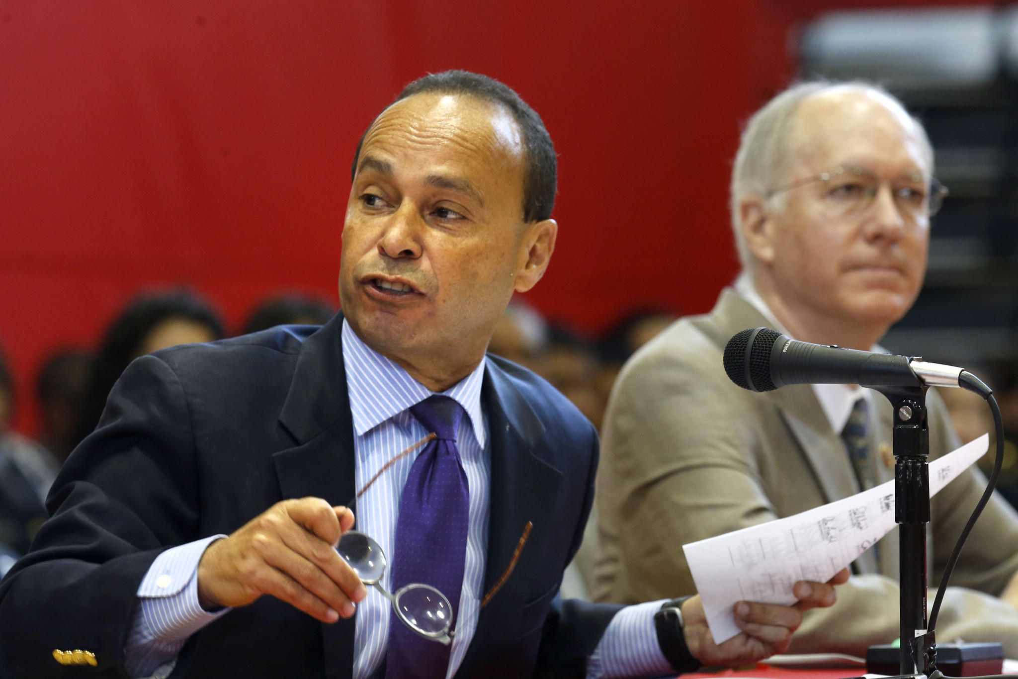 U.S. Rep. Luis Gutierrez, left, speaks at a Senate hearing in May.